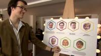 A man plays pin the policy on the politician