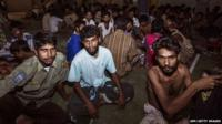 A group of rescued migrants mostly Rohingya migrants from Myanmar and Bangladesh, passengers of the first migrants boat, are temporarily housed at a government sports auditorium in Lhoksukon in Aceh province