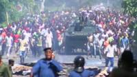 Crowds in Bujumbura surrounding a tank as they celebrate news of the overthrow of President Nkurunziza
