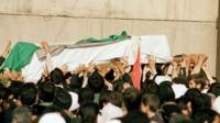 Khomeini's coffin held aloft by mourners