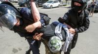 Police make an arrest in Kiev, 6 June 2015