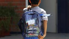 School student carrying clear backpack