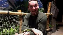 Newsround presenter Martin Dougan with an insect from the annual count at Chester Zoo