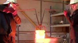 Craftsmen forging metal