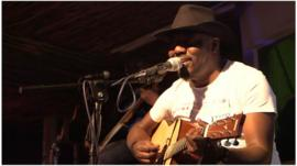 Sir Elvis playing the guitar in Nairobi