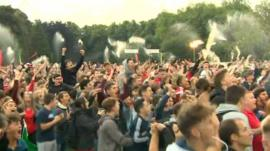 Supporters in the fan zone in Cooper's Field, Cardiff celebrate as Hal Robson-Kanu scores