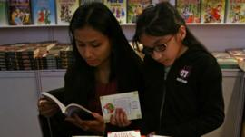 Mum and daughter reading books