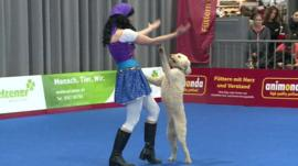A woman dancing with a dog