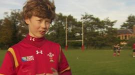 Boy in Wales rugby shirt