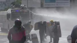 Water cannon is used on protesters in Caracas (18 May)