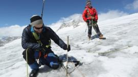 Scientists researching a glacier