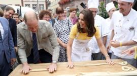 Duke and Duchess of Cambridge make pretzels