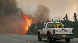 Firefighters tackle wildfires in Alaska