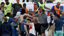 Groups of supporters clash at the end of the Euro 2016 group B football match between England and Russia at the Stade Velodrome