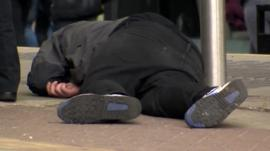 Man passed out in street