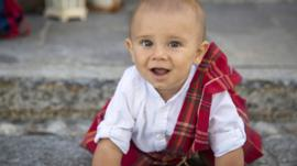 A baby wearing tartan in Gurro