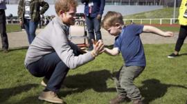 Prince Harry spars with little boy