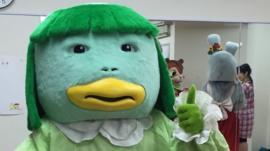Leah in her mascot costume in Japan