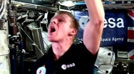 Tim Peake drinking water in space