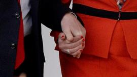 Trump and May holding hands