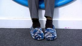 A child wears slippers to school