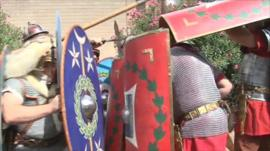 Museum staff act out a Roman battle