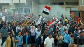 Demonstrators march through Syrian city of Daraa