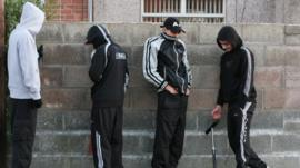 Young boys playing truant hiding their faces