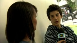 Leah interviewing a boy