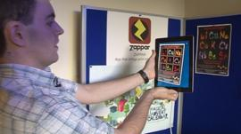 Simon Taylor sets a poster alight using an augmented reality app on his iPad