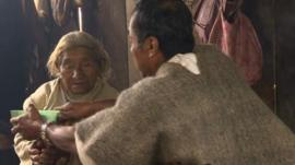 Traditional Mayan healer working with patient