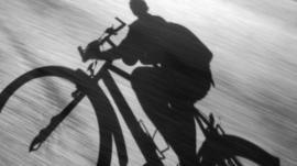Shadow of cyclist