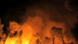 Wildfire lighting night sky