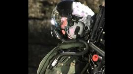 A crash test dummy wearing a helmet.