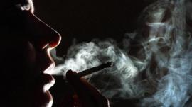 Silhouette of woman smoking