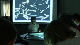 Pupils at interactive school desks