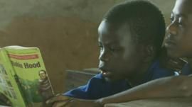 Children at a school in Ghana reading a book