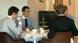 Young boys eating lunch