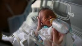Feeding a baby in China