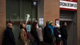 People queue to enter a government job centre in Madrid, Spain.