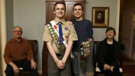 Pascal Tessier, 16, center and his brother Lucien Tessier, 20, pose for a portrait with their parents.