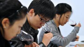 Three Chinese students wine-tasting in Bordeaux