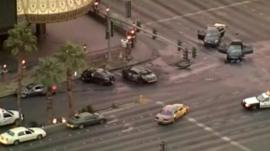 Police cars surround the crashed and burnt cars in Las Vegas