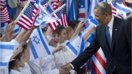 President Obama greets children waving US and Israeli flags