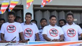 Sri Lanka's hardline Buddhist group Bodhu Bala Sena members wear T- shirts urging boycott of consumer goods with Halal certification during a protest rally in Maharagama on the outskirts of Colombo, Sri Lanka, Sunday, Feb. 17, 2013
