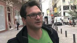 Greek man who taken paycut