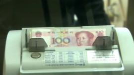 Yuan notes being counted in automatic machine