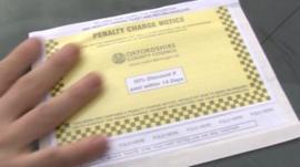 Parking attendants issue a fine in Oxford