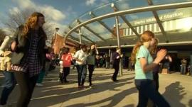 Dancers greeted the transport secretary at Derby Station.