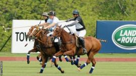 Prince Harry playing polo
